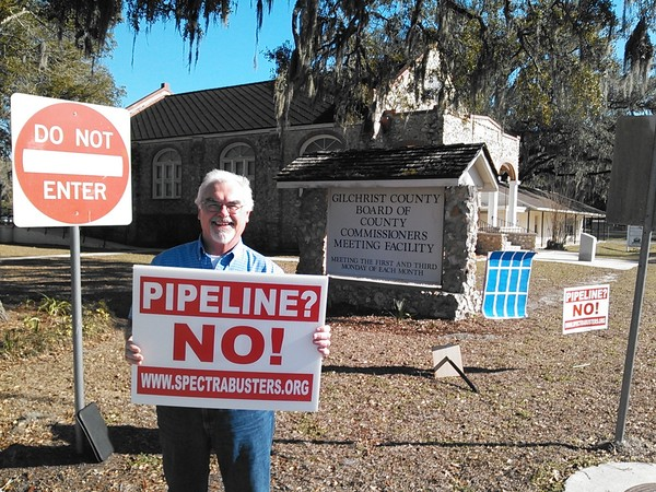 Pipeline? No! www.spectrabusters.org at Gilchrist County Commission with SAVE solar panel, in Gilchrist County Commission, by John S. Quarterman, for SpectraBusters.org, 20 February 2014