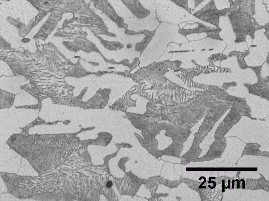 900x675 Figure 12. Light photomicrograph of the typical base metal microstructure from Mount M2 (4% Nital Etchant)., in Pilot Grove, MO PEPL explosion, by John S. Quarterman, for SpectraBusters.org, 25 August 2008