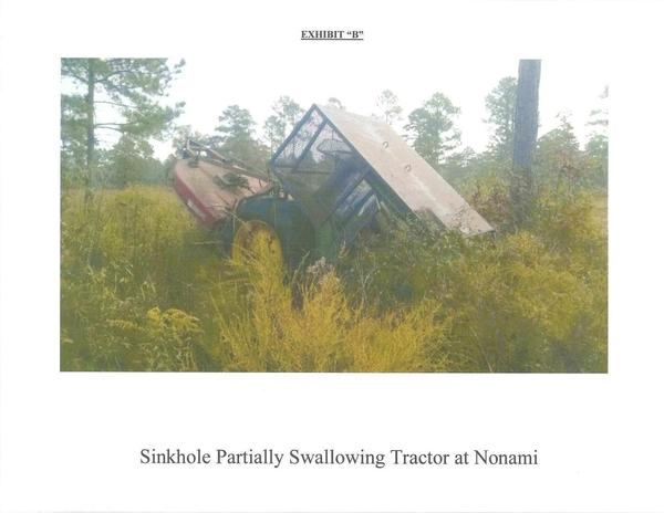 600x464 Exhibit B: Sinkhole Partially Swallowing Tractor at Nonami, in Nonami, by John S. Quarterman, for SpectraBusters.org, 13 November 2014